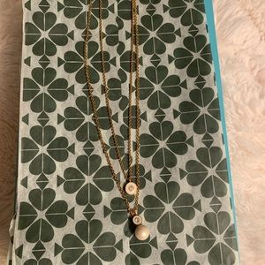 layered Kate Spade necklace.